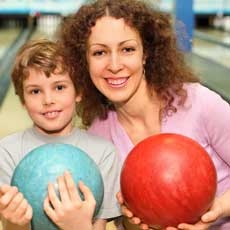 Things to do in Greater Lansing, MI for Kids: Family Cosmic Bowling, City Limits Sports Bar & Bowling Center